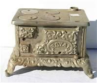 """165: Royal cast iron childs stove 7 1/2"""" long & toy cof"""