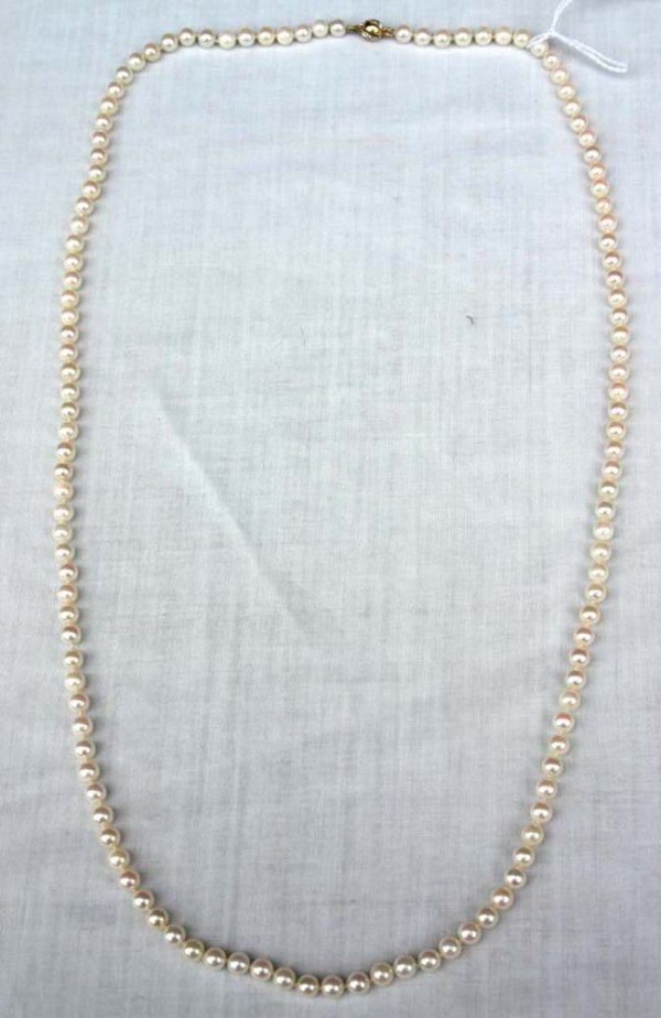 "1003: 30"" long strand of cultured pearls w 14k gold & d"