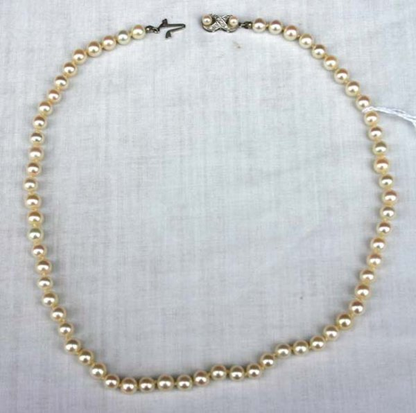 "1004: 18"" long strand cultured pearls w 18k white gold"