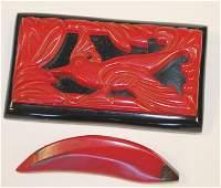 lot of 2 Vintage Bakelite carved red pins incl carved
