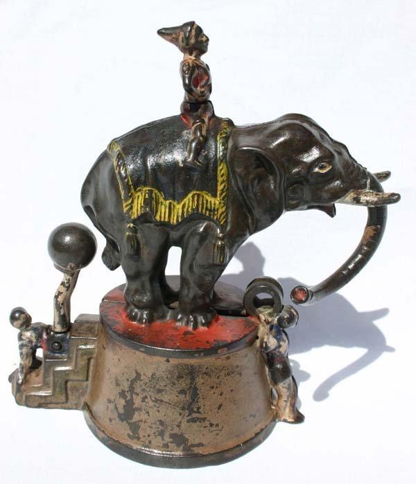 1: antique cast iron mechanical bank by J.E. Stevens 18