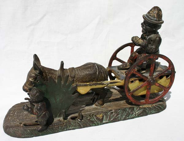 2: antique cast iron mechanical bank by J.E. Stevens ca