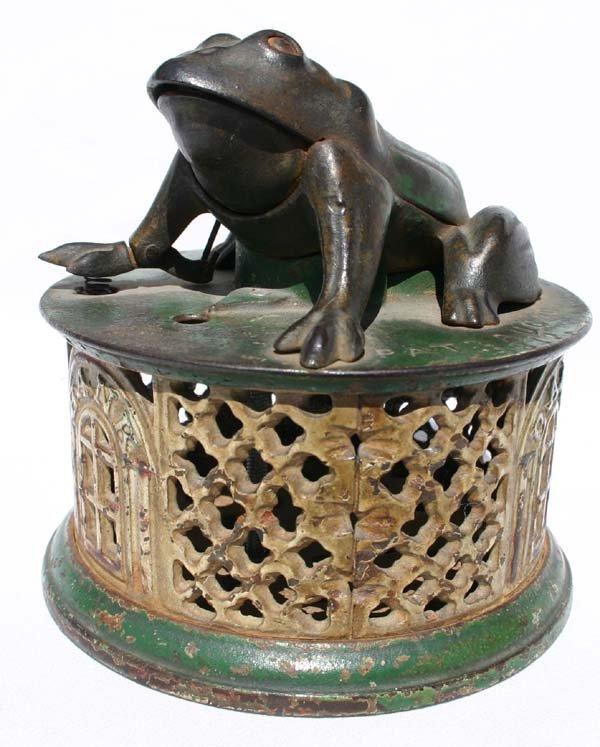 7: antique cast iron mechanical bank by J.E. Stevens ca