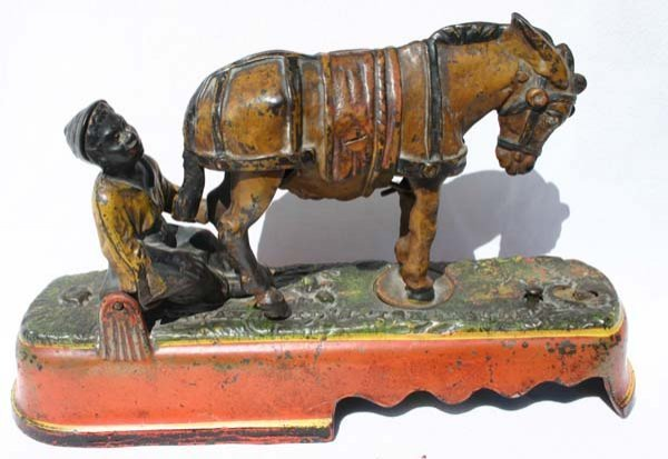 8: antique cast iron mechanical bank by J.E. Stevens ca