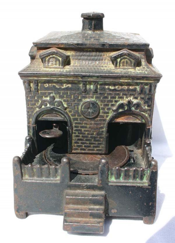 14: antique cast iron  mechanical bank Judd Co ca 1870