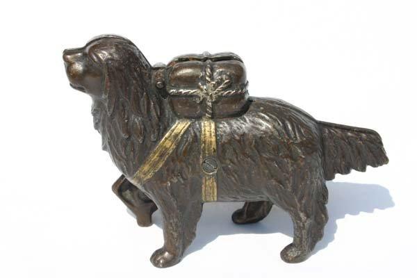 20: antique cast iron dog bank w parcel on back