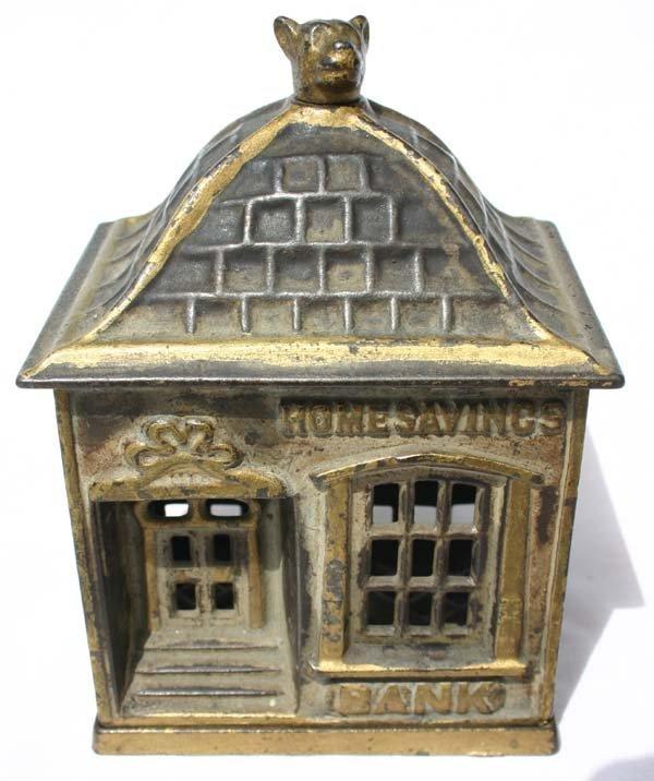 21: antique cast iron Home Savings Building bank w anim