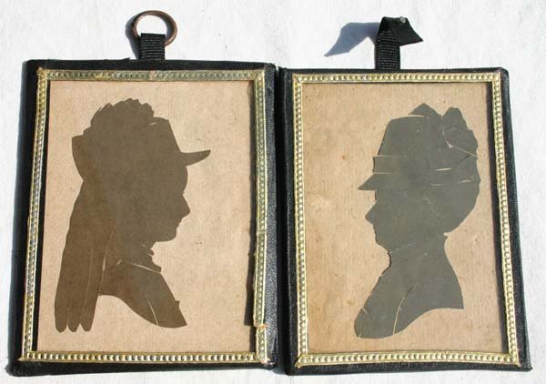 1016: ca 1870 pr of leather framed silhouettes