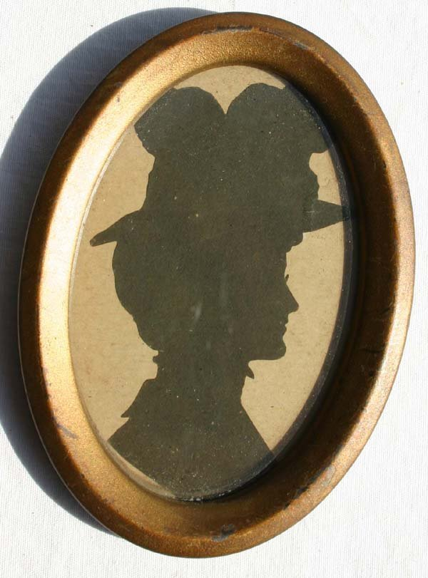 1017: Victorian oval framed hollow cut silhouette of a