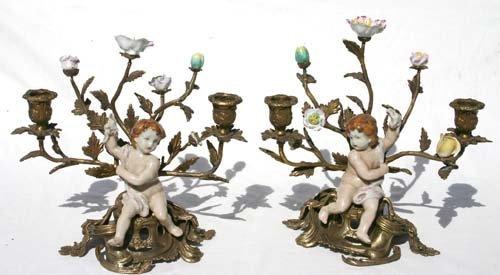 353: Nice pr brass & porcelain putti figural candleabru