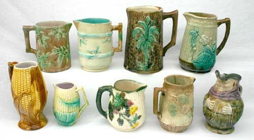 7: lot of 9 Majolica pitchers - incl 1 Toby