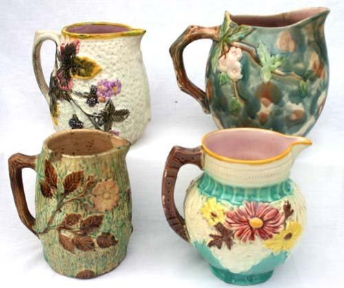 12: lot of 4 antique Majolica lg pitchers incl 1 Griffi