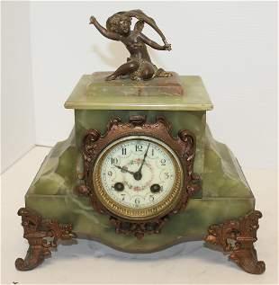 French onyx clock w porcelain face & cherub figural