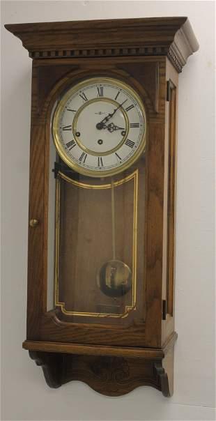 "Howard Miller German oak wall clock - 29 1/2"" x 14 1/2"""