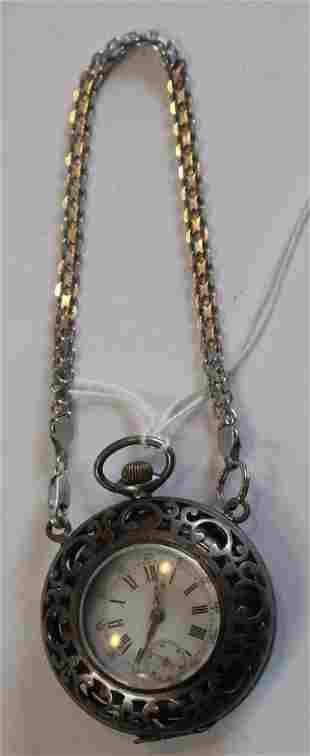 Antique pocket watch marked .800 in filigree case
