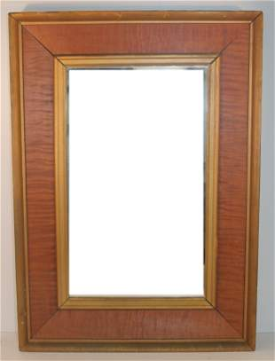 Antique tiger maple framed mirror in untouched surface