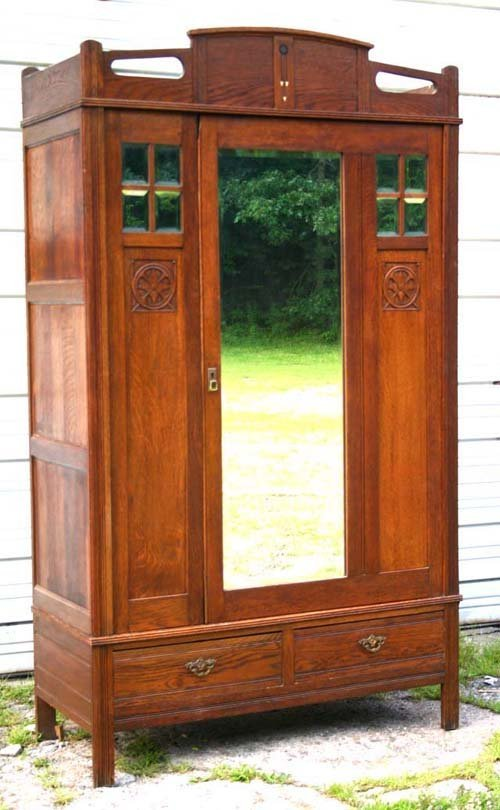 15: fine quality Arts&Crafts period carved oak armoire