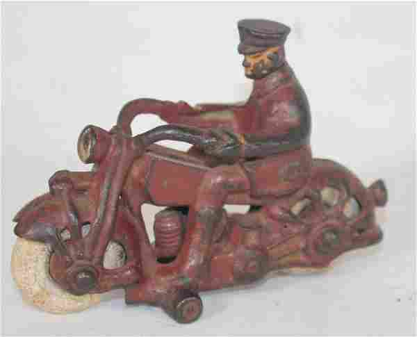 Antique cast iron motorcycle w rider in red paint &