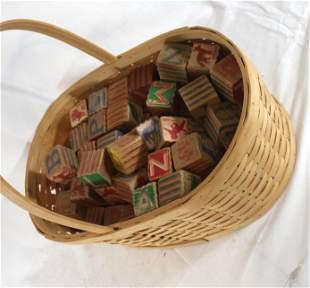 Large basket full of wooden children's blocks
