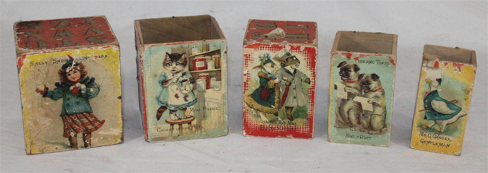 Antique wooden nest of blocks w lithograph decoration -