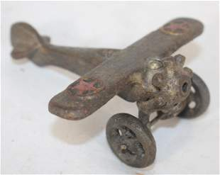 """Cast iron airplane w red stars on top wing - 4 1/2"""""""