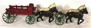 Cast iron horse drawn wagon w extra set of horses -
