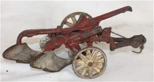 "Arcade cast iron plow - 7"" long"