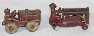 2 Cast iron tractors incl an as found Arcade in red