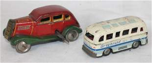2 small tin vehicles incl wind-up red & green sedan &