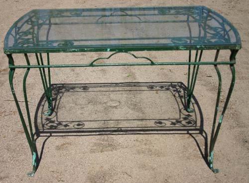1E: wrought iron glass top patio table w paw feet - 4'l