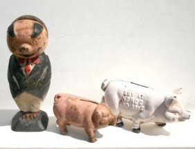 9: 3 cast iron pig still banks - 1 marked Norco Foundry