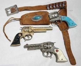 "20: 3 ""Texan Jr"" Western toy guns w 1 holster & bullets"