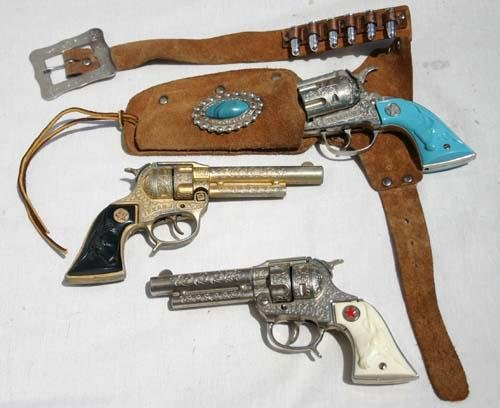 "20: 3 ""Texan Jr"" Western toy guns w 1 holster & bullets"