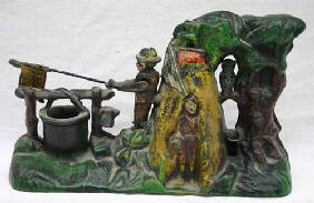 24: cast iron Boy Scout mechanical bank in orig paint