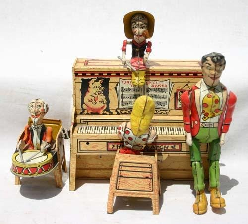 """329: Unique Art tin wind up """"Lil Abner Dogpatch Band"""""""