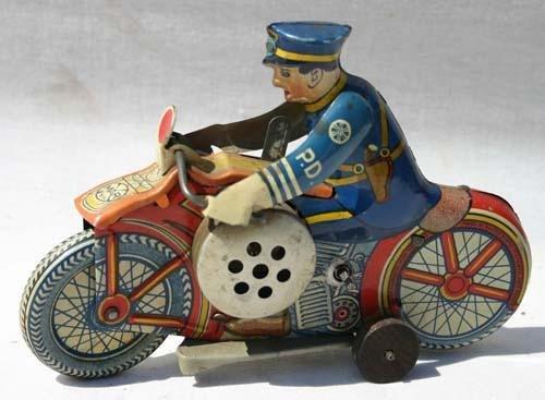 "338: Marx tin wind up 8"" motorcycle cop w siren"
