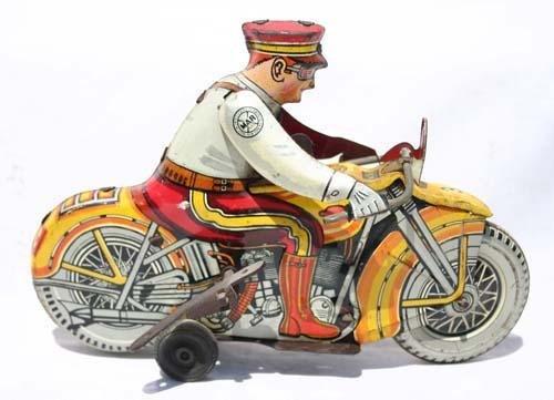 "339: Marx tin wind up 8"" motorcycle cop w siren"
