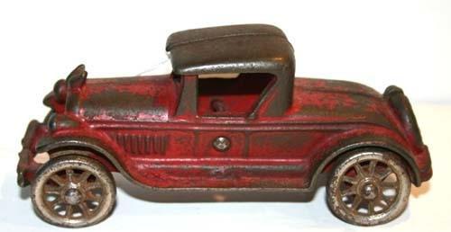 "348: antique cast iron 6"" coupe w winged radiator cap &"