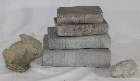 lot of cement garden decorations incl a stack of books