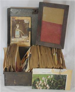 Collection of gardening notes in a storage tin together