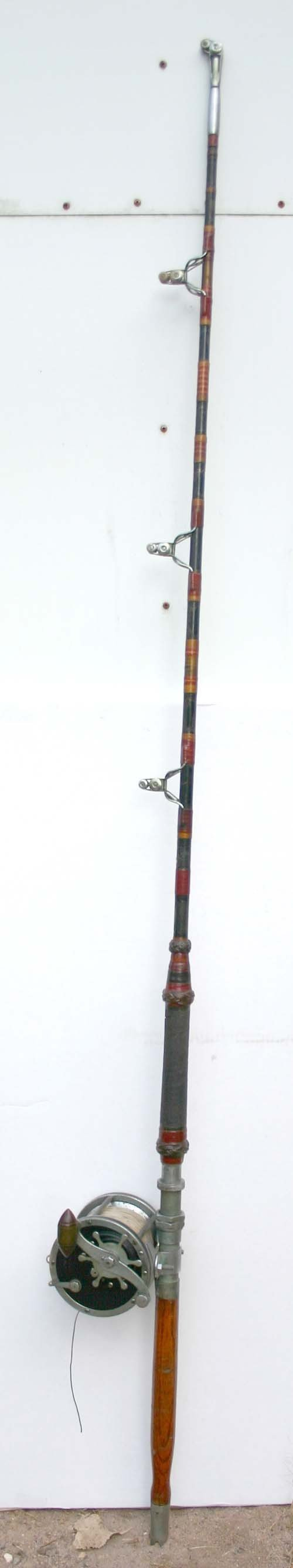 18: large antique salt water fishing pole and reel - po