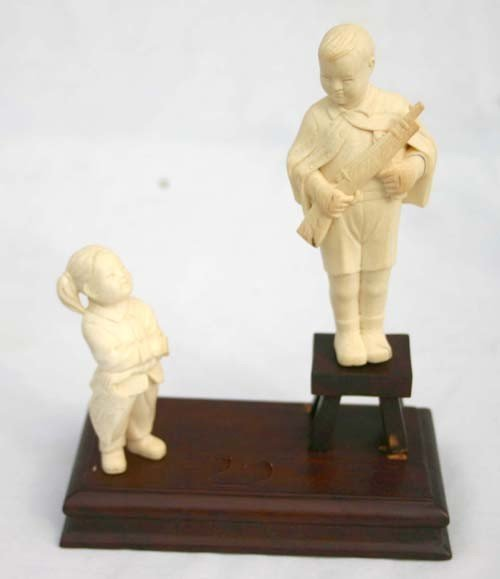 "159: fine Chinese carved ivory figure of a boy (4"") & g"