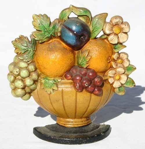 """204: antique cast iron """"Fruit Basket"""" doorstop by Huble"""