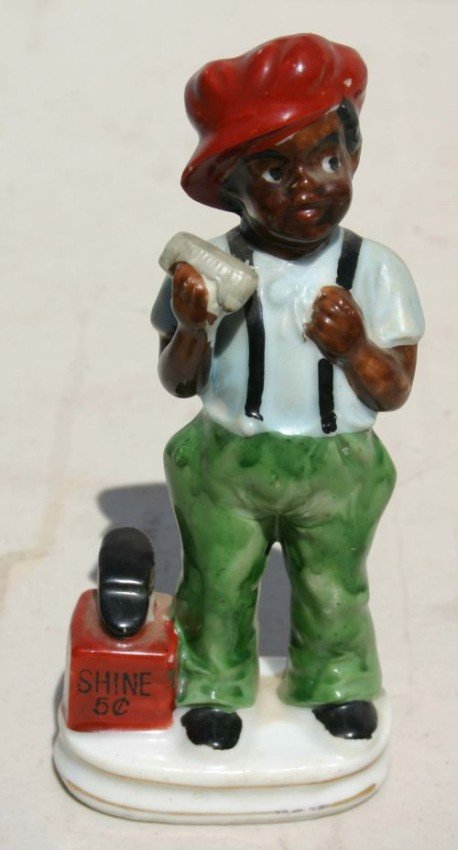 11: Occupied Japan figure of an African American Shoe S