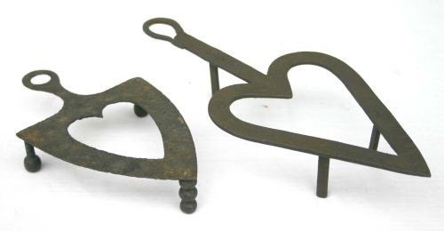 184: 2 great antique heart form all orig iron trivets c