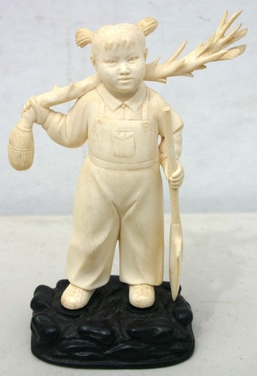 196: Chinese carved ivory figure of a young girl w pigt