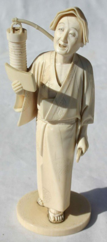 198: Chinese carved ivory figure of a woman w fan in on
