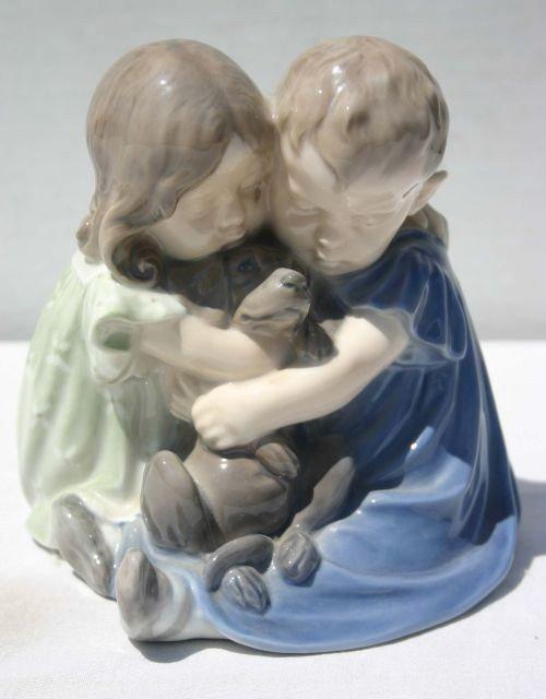 12: Royal Copenhagen figurine No.707 of 2 children w a