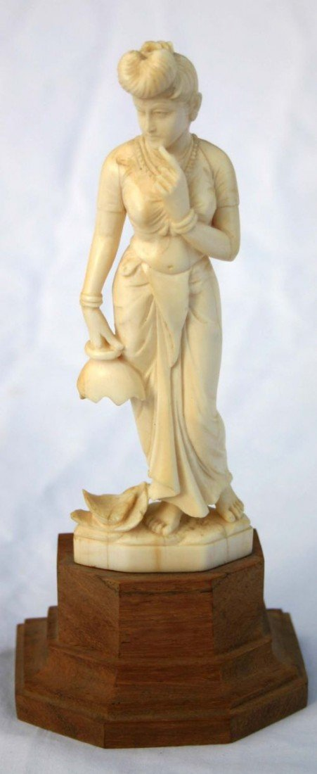 13: Chinese carved ivory figure of a woman carrying a b