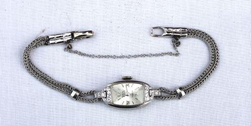 19: 14k Sellita platinum & diamond ladies wrist watch f